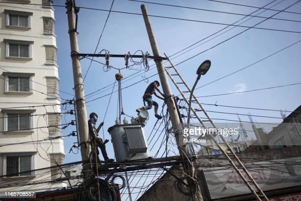 Workers seen doing risky job as they repair electric transformers without wearing anything for safety in Dhaka Bangladesh on 2 September 2019