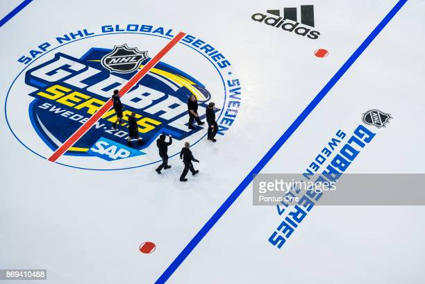 Workers seen on the ice during the rink build out ahead of the SAP NHL Global Series between Ottawa Senators and Colorado Avalanche at Ericsson Globe...