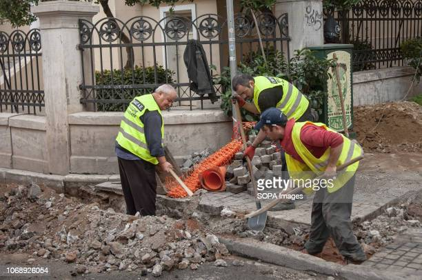 Workers seen working on a trench in the center of Athens Greece
