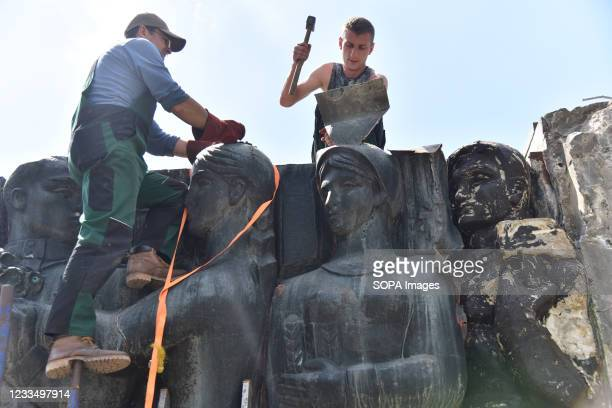 Workers separate parts of the bas-relief from the Monument of Glory. Work on the liquidation of the Soviet complex of the Monument of Military Glory...