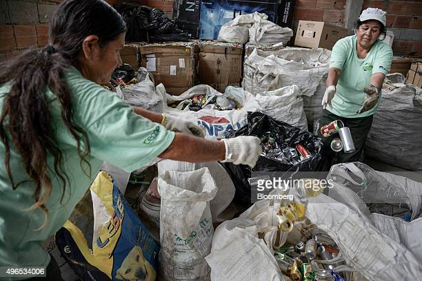 Workers separate trash from aluminium for recycling at Cooperativa de Trabalho Moreira Recicla in Pindamonhangaba Brazil on Wednesday Nov 4 2015...