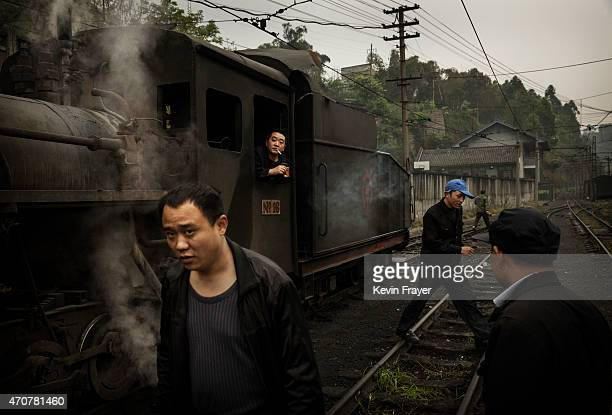 Workers service a local coal powered steam train before departing on a trip carrying local villagers on March 27 2015 at a station in the town of...
