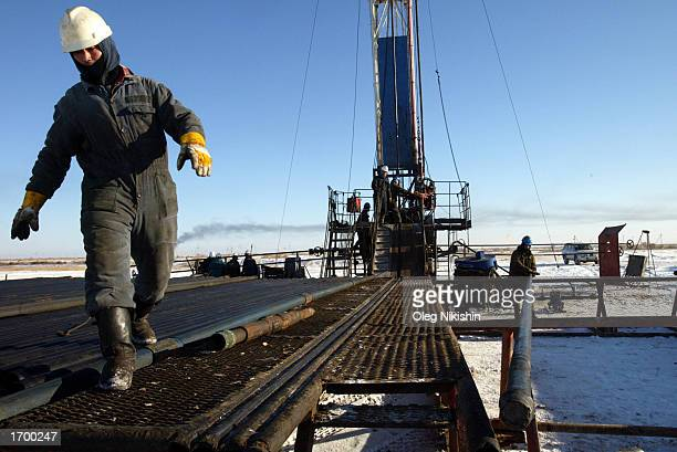 Workers service an oil well owned by the Canadian oil company Hurricane Kumkol Munai December 20 2002 about 200 km north of Kyzylorda Kazakhstan...