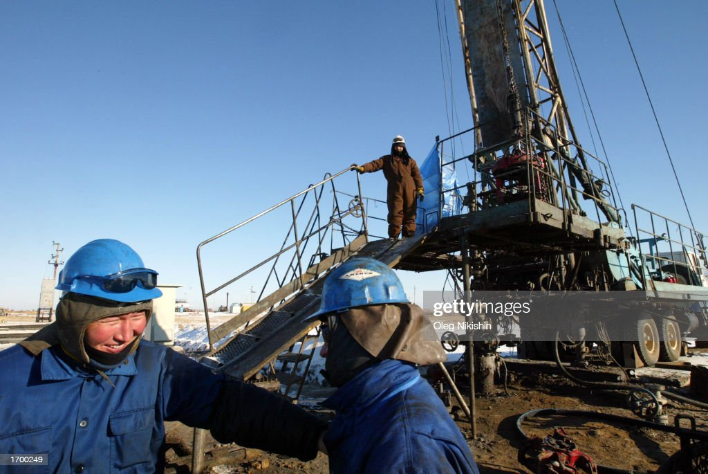 Workers service an oil well owned by the Canadian oil company Hurricane Kumkol Munai December 20, 2002 about 200 km (124 miles) north of Kyzylorda, Kazakhstan. Hurricane Hydrocarbons Ltd. is an international energy corporation engaged in the acquisition, exploration, development, production, refining and marketing of oil in the Republic of Kazakhstan. The company has been involved in joint ventures in Kazakhstan since 1991 and participated in the country?s first major oil and gas privatization in November 1996. Hurricane purchased a state-owned oil production company, Yuzhneftegaz, and renamed it Hurricane Kumkol Munai. In 2002, average oil production has been 115,000 barrels a day.