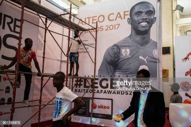 Workers set up a billboard bearing the picture of Antalyaspor's forward Samuel Eto'o of Cameroon during preparations ahead of the Confederation of...