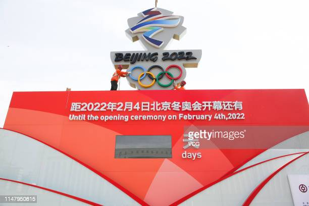 Workers set up a countdown board reading 'Beijing 2022' ahead of the 1,000-day countdown to 2022 Winter Olympics on May 8, 2019 in Zhangjiakou, Hebei...
