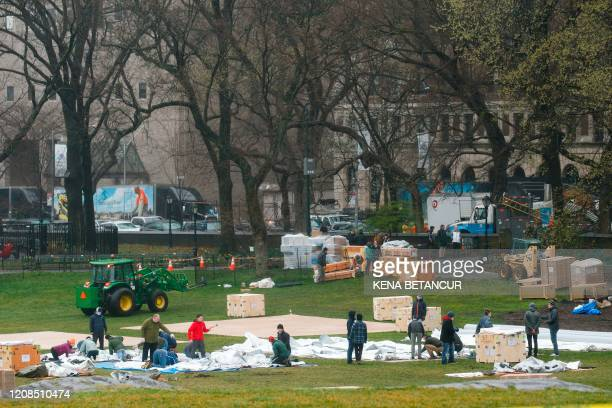 TOPSHOT Workers set up a field hospital in front of Mount Sinai West Hospital inside Central Park on March 29 2020 in New York City A senior US...