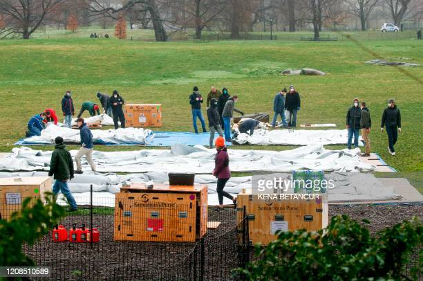 Workers set up a field hospital in front of Mount Sinai West Hospital inside Central Park on March 29 2020 in New York City A senior US scientist...