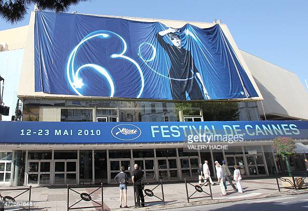Workers set up a hoarding advertising the Cannes' film festival 63rd edition on the Festivals' palace facade on May 10 2010 in Cannes southeastern...