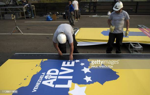 Workers set up a stage for a concert organized by British billionaire Richard Branson to raise money for the Venezuelan relief effort in Cucuta...