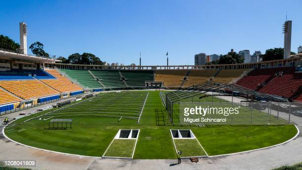 Workers set up an emergency specific makeshift hospital at Pacaembu Stadium for Coronavirus patients with a capacity of 200 beds on March 23, 2020 in...