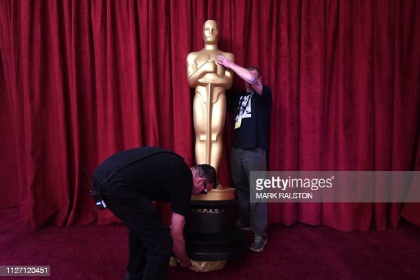 Workers set up an Oscars statue as preparations are made ahead of the 91st Annual Academy Awards at the Dolby Theatre in Hollywood California on...