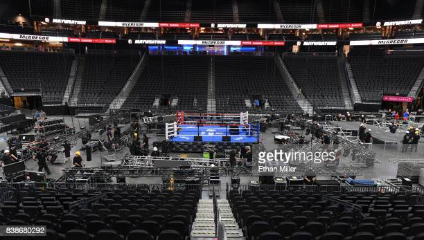 Workers set up at TMobile Arena ahead of the weighin and bout between boxer Floyd Mayweather Jr and UFC lightweight champion Conor McGregor on August...