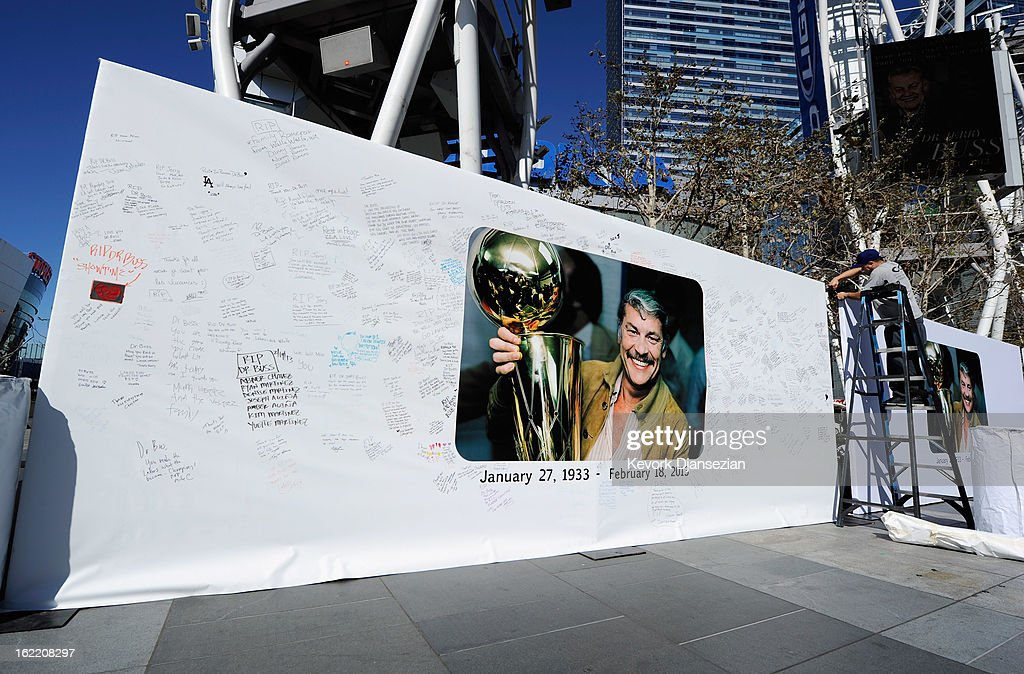 Workers set up Dr. Buss Memorial Banners in the Nokia Plaza at L.A. Live, directly across the street from Staples Center on February 20, 2013 in Los Angeles, California. The Lakers will hold a memorial service to celebrate the life of longtime owner Jerry Buss at the Nokia Theater on Thursday, for invited guests only. Dr. Buss died at the age of 80 on Monday following an 18-month battle with cancer.