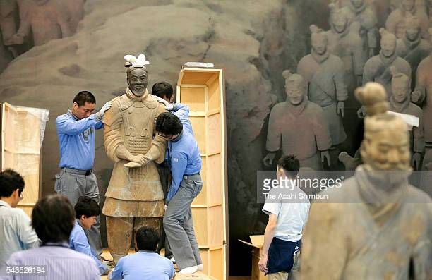 Workers set up in preparation for 'Tthe Great Terracotta Army of China's First Emperor 'exhibition at the National Museum of Art Osaka on June 28...