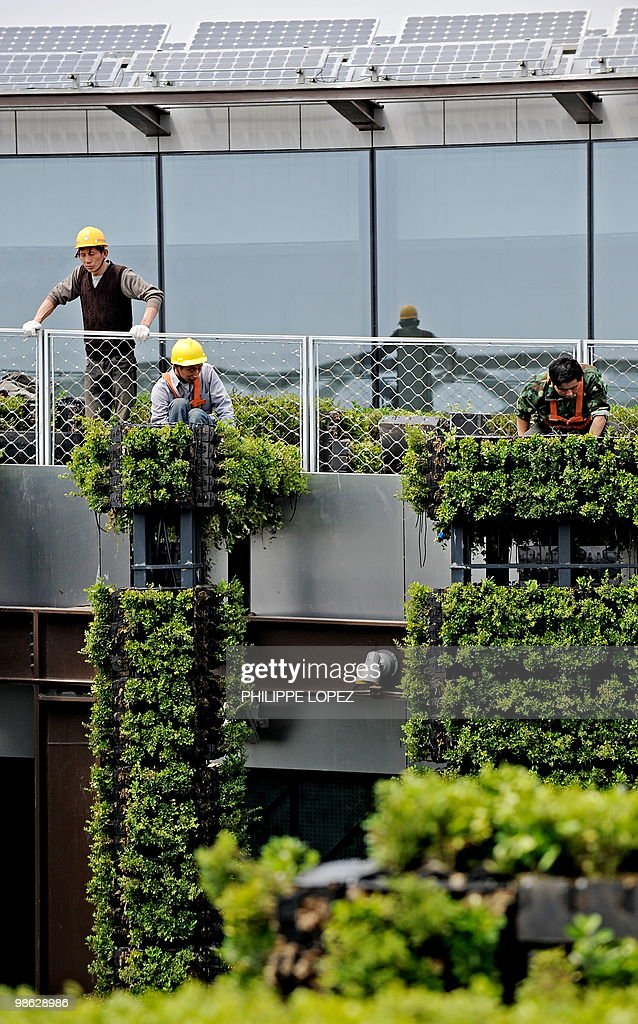 Workers set up plants at the French pavilion at the site of the World Expo 2010 in Shanghai on April 23, 2010. Expo organisers gave members of the public a preview of the largest-ever World's Fair as they tested facilities and public transportation before the official start on May 1.