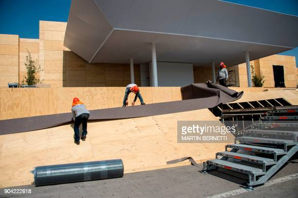 Workers set up the stage in which Pope Francis will officiate the first open airmass during his visit to Chile at O'Higgins park in Santiago on...