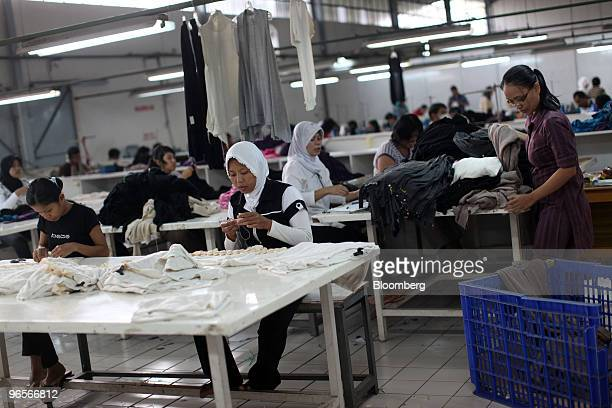 Workers sew clothing at a garment factory in Bandung West Java Indonesia on Wednesday Feb 10 2010 A freetrade agreement between China and Southeast...
