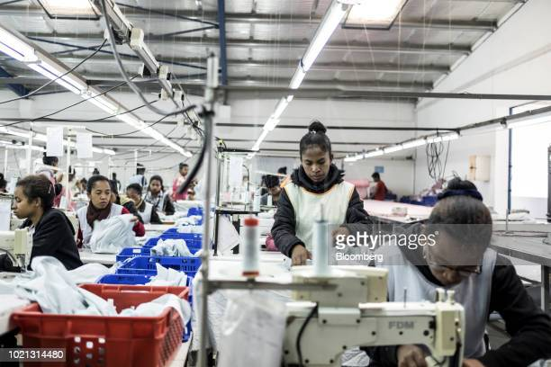 Workers sew garments at a textile manufacturing facility in Antananarivo Madagascar on Wednesday July 25 2018 Madagascar's exports are projected to...