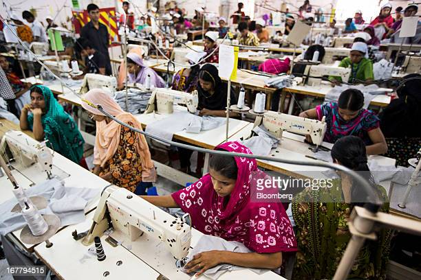 Workers sew garments on the production line of the Protik Apparels garment factory in Dhaka Bangladesh on Monday April 29 2013 Bangladesh authorities...