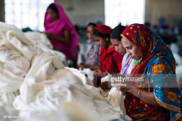 Workers sew garments on the production line of the Vintage Apparels Ltd garment factory in Dhaka Bangladesh on TMonday April 29 2013 Bangladesh...