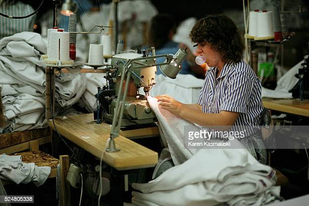 Workers sew sweatshirts at the McDowell County Apparel factory in Bradshaw West Virginia | Location Bradshaw West Virginia USA