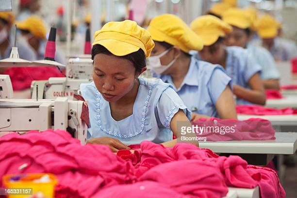 Workers sew women's dresses on the production line in the garment area at a PT Sri Rejeki Isman factory in Sukoharjo Java Indonesia on Wednesday...