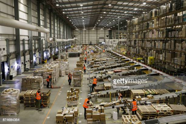 Workers ship prepare orders for shipment at an Amazoncom Inc fulfillment center in Peterborough UK on Wednesday Nov 15 2017 As Amazon's share of...