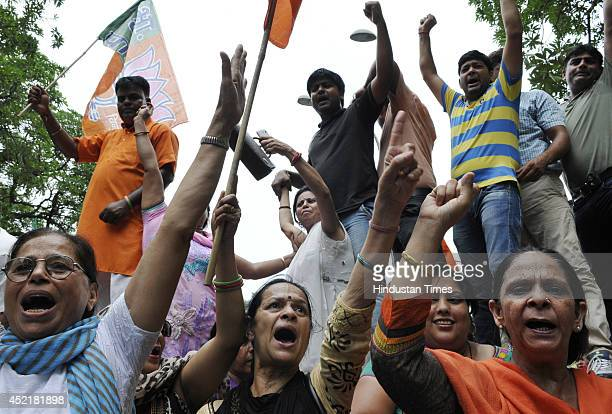 BJP workers shout slogan during their protest at the BSES headquarters in Nehru Place against the high Electricity prices on July 15 2014 in New...