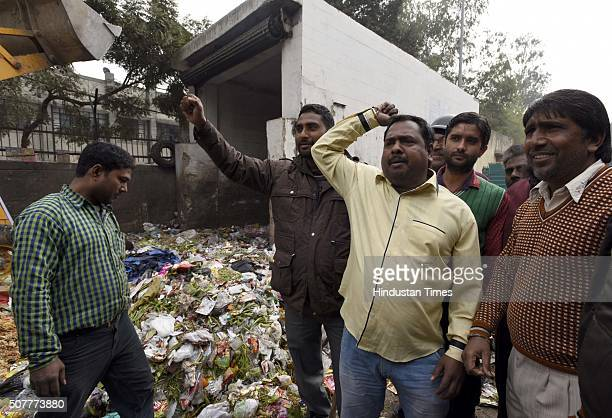 MCD workers shouting against Deputy Chief Minister of Delhi Manish Sisodia after his visit and inspection of the garbage during their protest over...