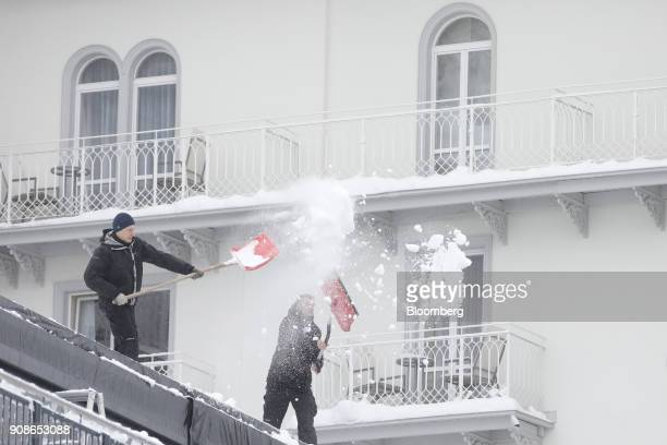 Workers shovel show from the Belvedere hotel after heavy snowfall ahead of the World Economic Forum in Davos Switzerland on Monday Jan 22 2018 World...