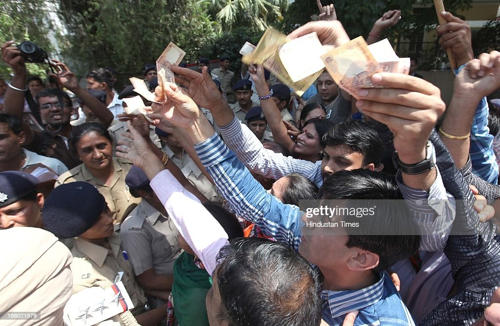 BJP workers showing the rupees during their protest against the Railway minister Pawan Kumar Bansal at his residence in sector 28 on May 4 2013 in...