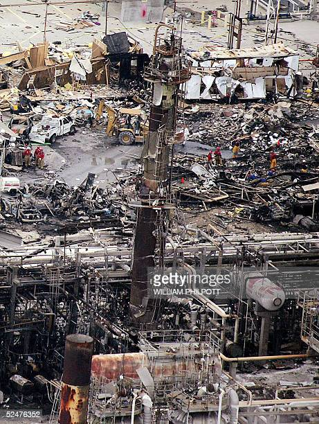 Workers sift through debris at the BP facility in Texas City 55 kilometers south of Houston, 24 March 2005, after an explosion. The death toll from...