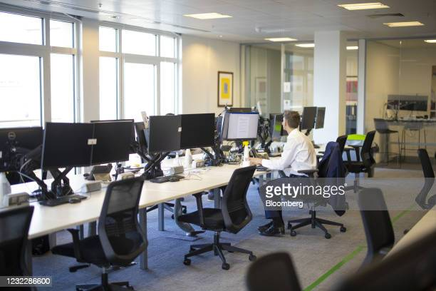 Workers sit at socially distanced desks in the offices of N+1 Singer Ltd., during a tour showcasing coronavirus safety measures, in London, U.K., on...