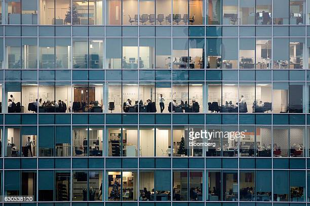 Workers sit at their desks in offices in the Broadgate Quarter of the City of London UK London UK on Tuesday Dec 20 2016 UK companies submitted their...