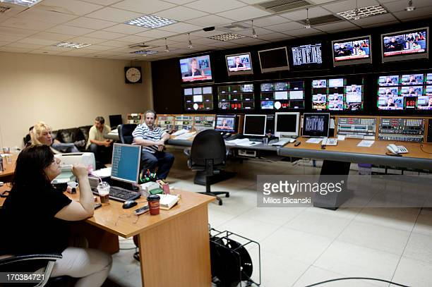 Workers sit in a production suite within the headquarters of the Greek public broadcaster ERT on June 12 2013 in Athens Greece Journalists have...