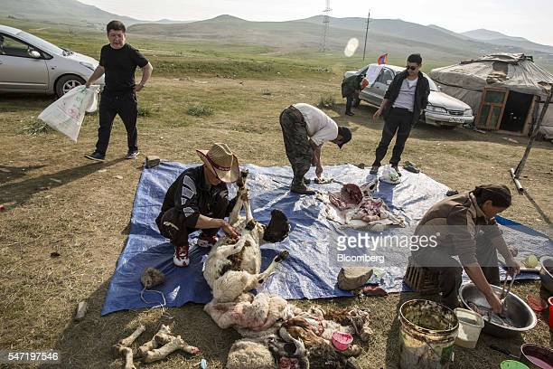 Workers slaughter and goats and sheep at a livestock market on the outskirts of Ulaanbaatar Mongolia on Wednesday July 13 2016 The nation's growth...