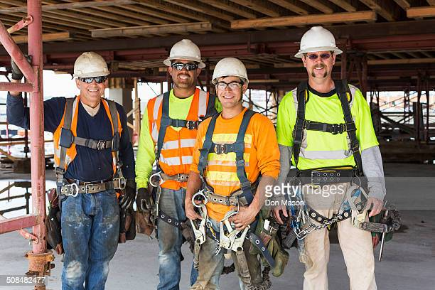 Workers smiling at construction site