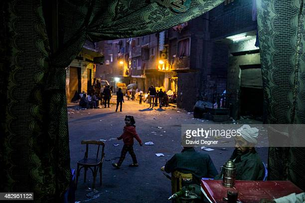 Workers smoke shish and drink coffee in a small coffee shop on December 17 2014 in Cairo Egypt Nestled under the cliff of Mokattam is Manshiyat Naser...