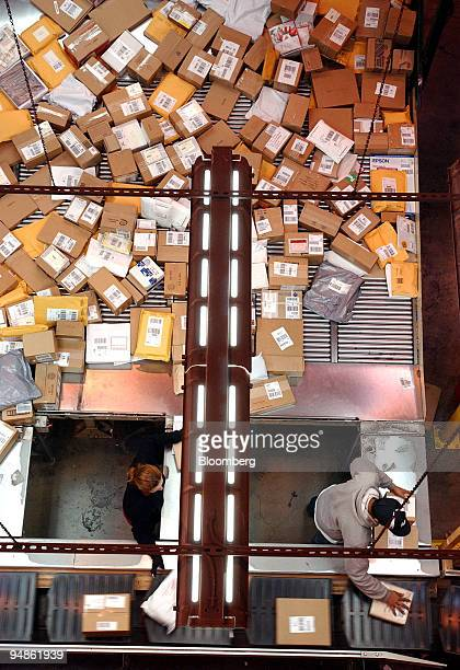 Workers sort packages at a FedEx Ground facility in Woodbridge, New Jersey on December 16, 2004. FedEx Corp., the No. 2 U.S. Package-delivery...
