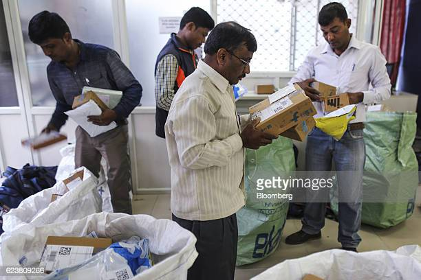 Workers sort packages at a Flipkart Online Services Pvt office in the Jayaprakash Narayan Nagar area of Bengaluru India on Wednesday Oct 26 2016...