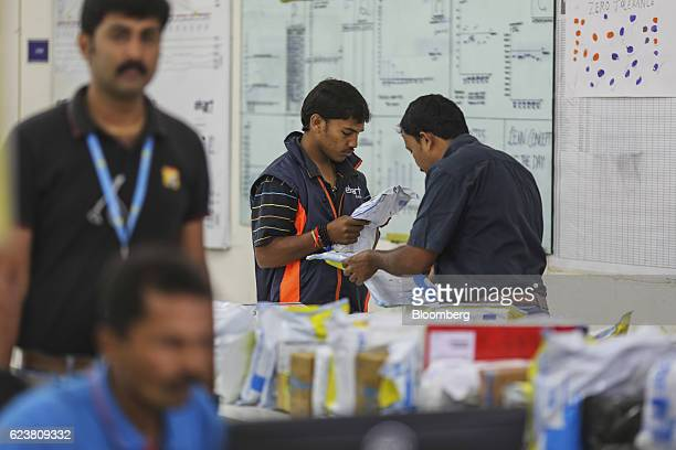 Workers sort packages at the Flipkart Online Services Pvt office in the Jayaprakash Narayan Nagar area of Bengaluru India on Wednesday Oct 26 2016...