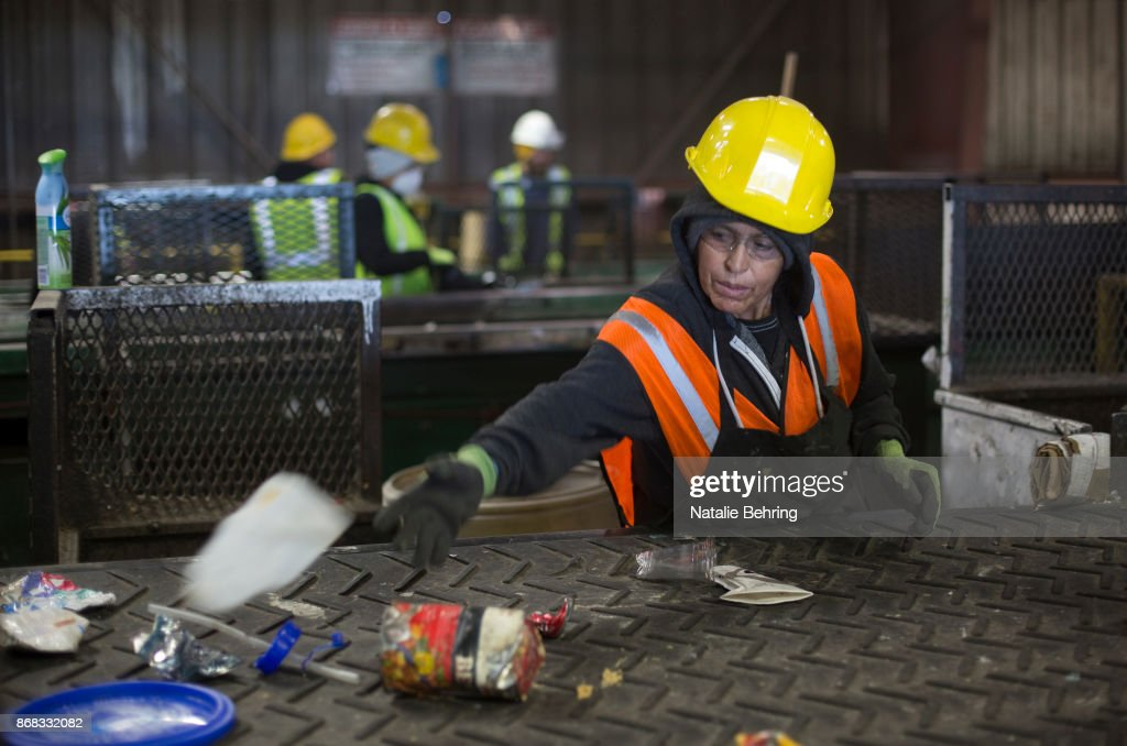 Workers sort paper and plastic waste at Far West Recycling October 30, 2017 in Hillsboro, Oregon. China is sharply restricting imports on recycled materials, and the impact will be felt across the Pacific Northwest. Some of the waste is likely to end up in the regions landfills as China rolls out new rules in January.