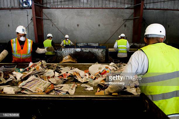 Workers sort recycling at the Allan Co sorting facility in San Diego California US on Monday Aug 13 2012 Allan Co founded in 1963 handles over one...
