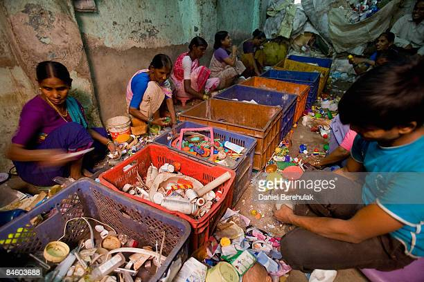 Workers sort through plastic for recycling in the Dharavi slum on February 3, 2009 in Mumbai, India. The redevelopment of asia's largest slum, the...