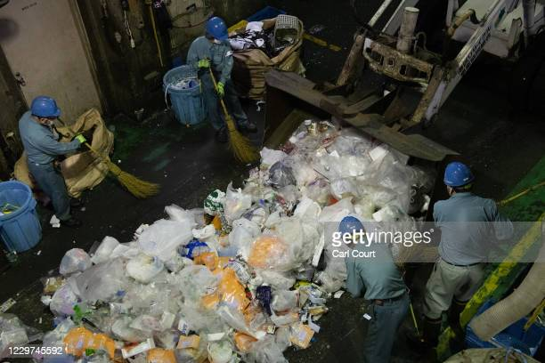Workers sort through plastic household waste at Minato plastic household waste at Minato Resource Recycle Centre on November 19 2020 in Tokyo Japan...