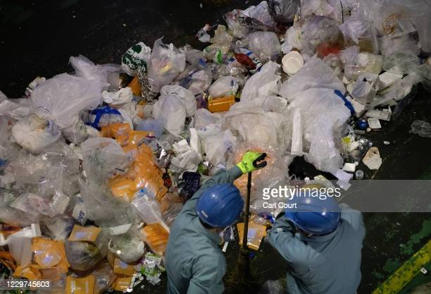 Workers sort through plastic household waste at Minato plastic household waste at Minato Resource Recycle Centre on November 19, 2020 in Tokyo,...