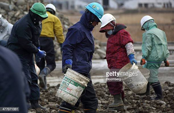 Workers sort through rocks at a construction site in Rikuzentakata Iwate Prefecture Japan on Thursday March 6 2014 Reconstruction of Tohoku the...