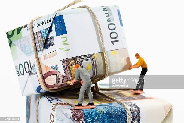 Workers sorting packages of euro notes