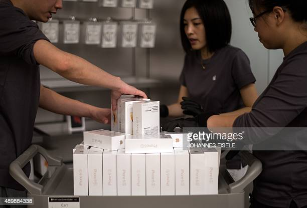 Workers sorts boxes of the Apple iPhone 6s during the release of the smartphone at an Apple store in Shanghai on September 25 2015 Apple launched the...